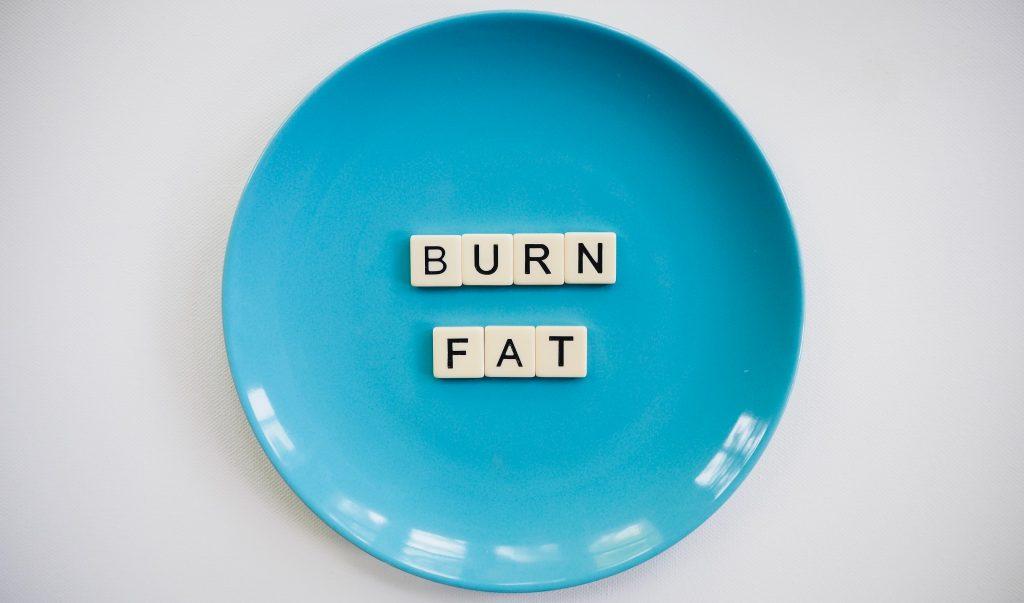 Burn Fat text inside a blue round plate