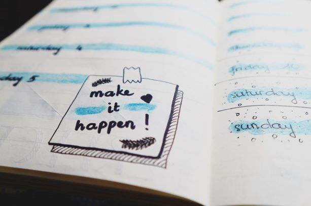 white paper with make it happen note